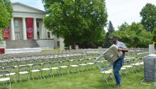 Putting out chairs on Old Morrison lawn