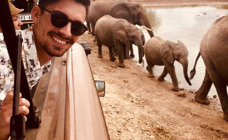 riding past elephants