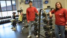 student and professor in gym