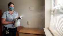 Spraying a disinfectant fogger