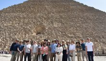 people in front of a pyramid
