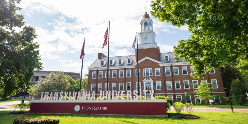 Transylvania University sign and flags in front of Carpenter Academic Center