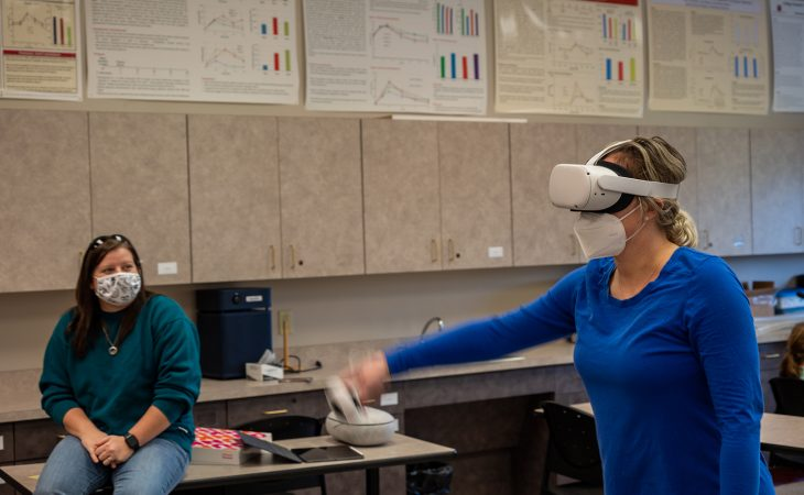 student playing a virtual reality game