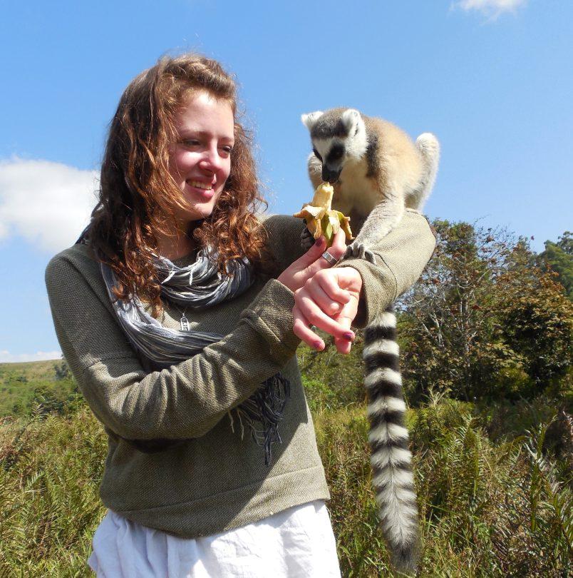 Raisa Tikhtman '14 feeds a lemur during her undergraduate travel to Madagascar, where she studied traditional medicine.