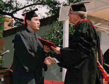 Paul Kim receiving his diploma in 2001
