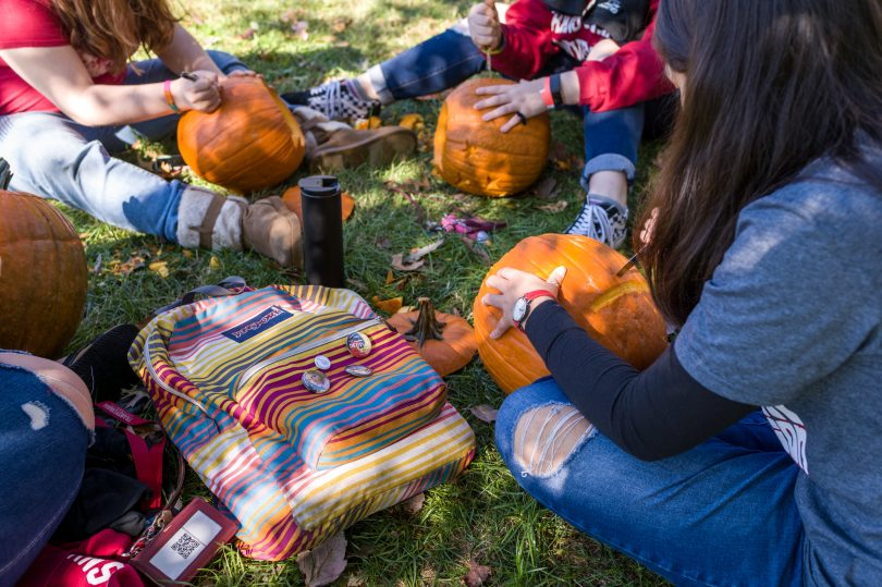 Students carving pumpkins at Transylvania University.
