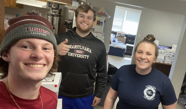 Transylvania lacrosse players recognize local firefighters with monster cookie delivery