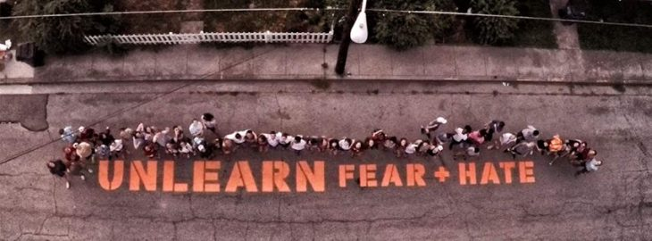 Unlearn Fear and Hate stencil from above