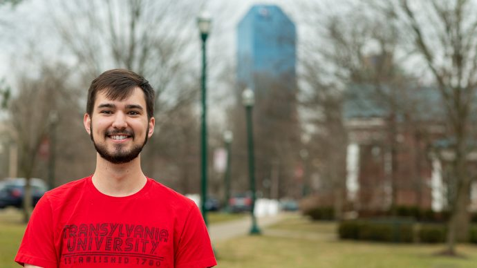 Transylvania student on campus with skyline in background