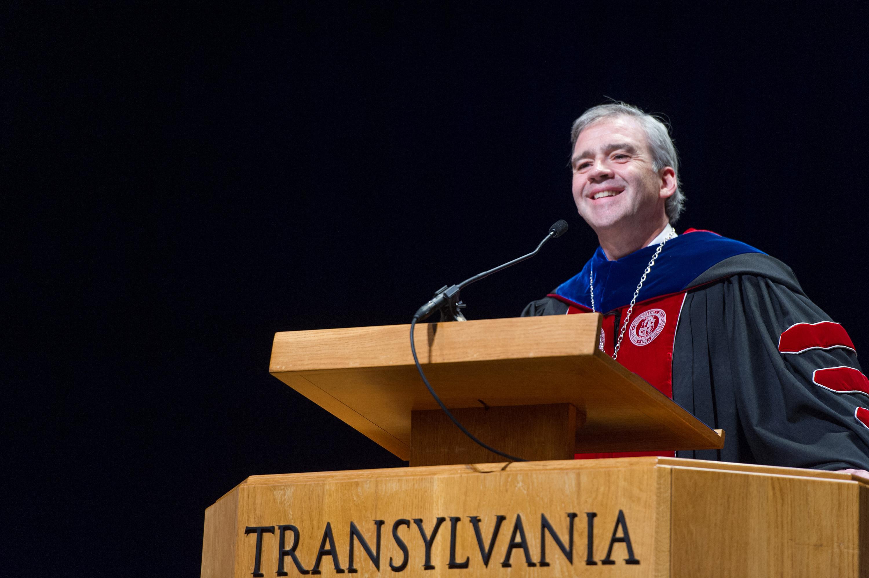 Dr Carey at a Podium