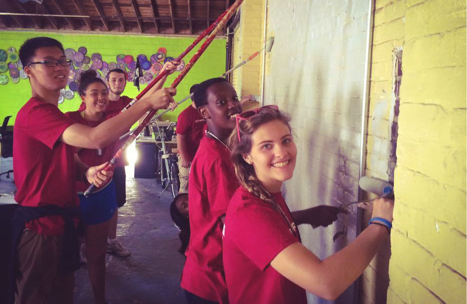 Transy students performing community service - painting a wall