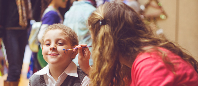 Student painting a child's face