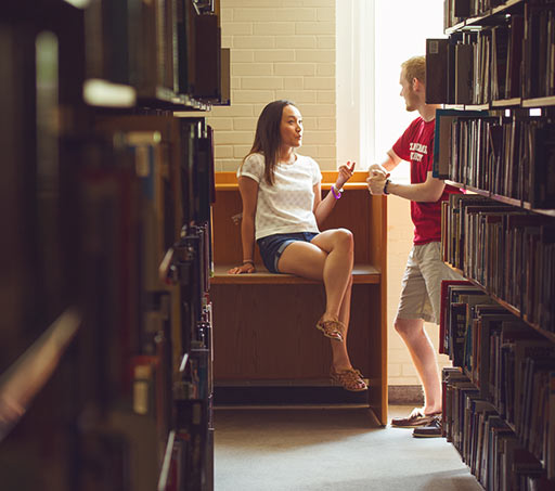 Photo of two students in the library
