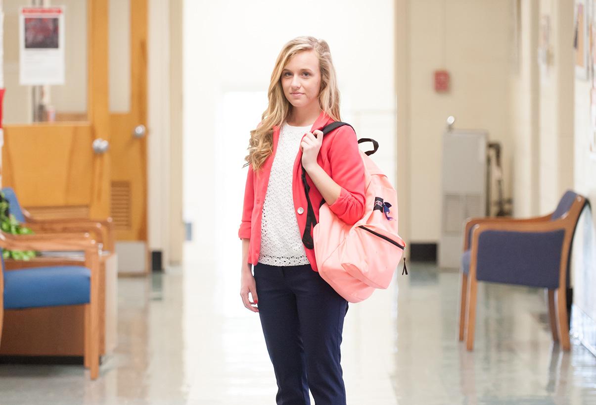 Student standing in hallway