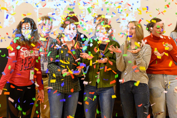 students showered in confetti