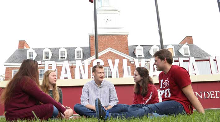 Five Students in front of Transylvania sign