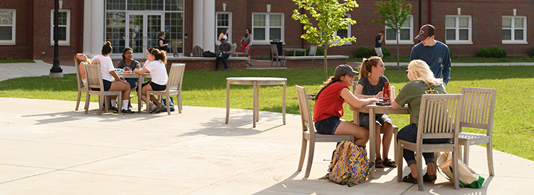 Students at a table on campus