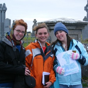 three students at local cemetary