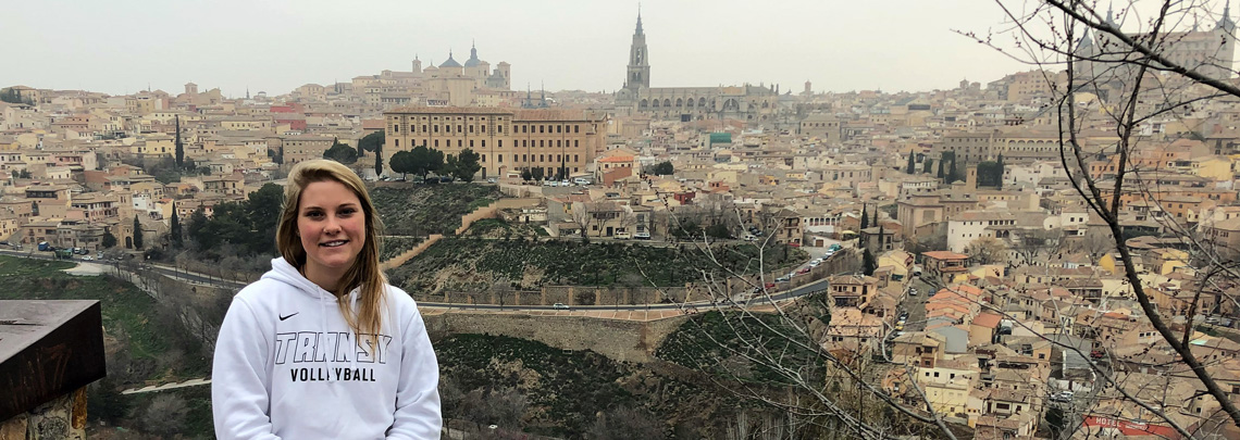Transy Student seated on a rock wall overlooking Toledo, Spain
