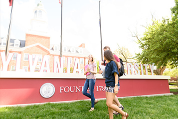 Students in front of Transylvania University Sign
