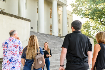 student leading on-campus group tour