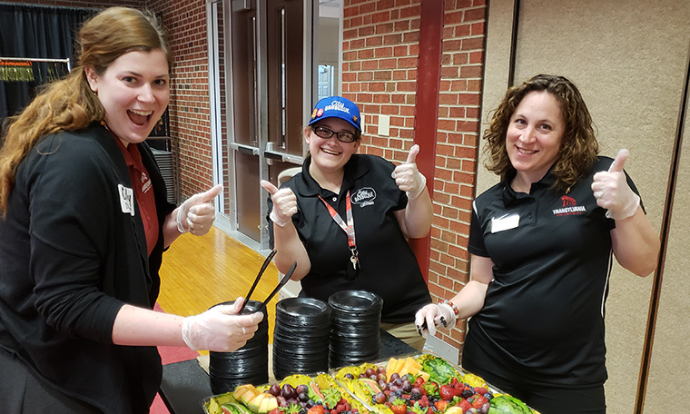 Food being served at a Crimson Compass Event
