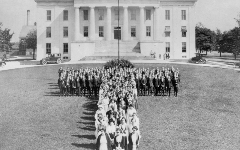 Archival photo of Transy Students standing in a 'T' formation in front of Old Morrison